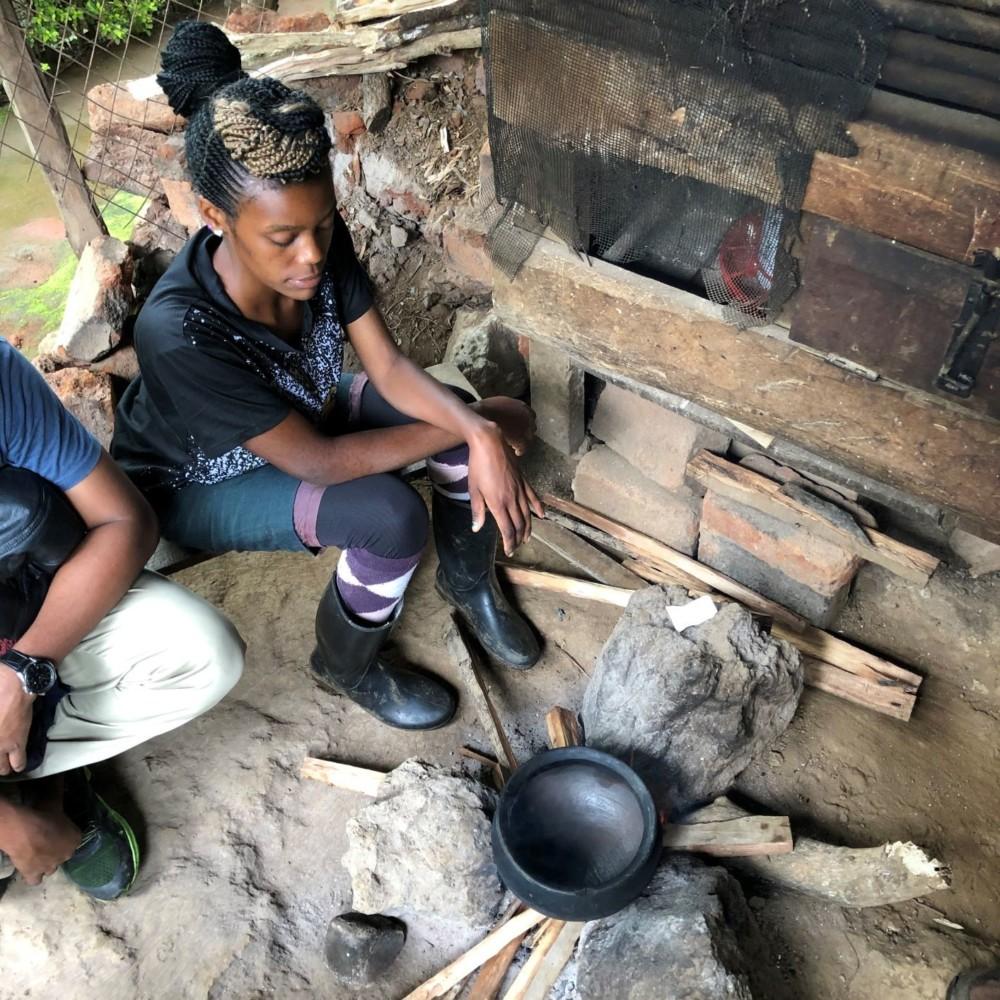 Furaha, coffee farmer roasting coffee